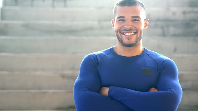 Muscular, mixed race young man, smiling, laughing video