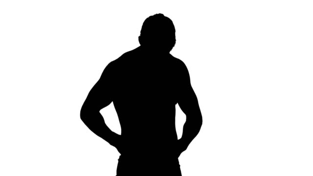 Muscular silhouette of man measuring his waist video