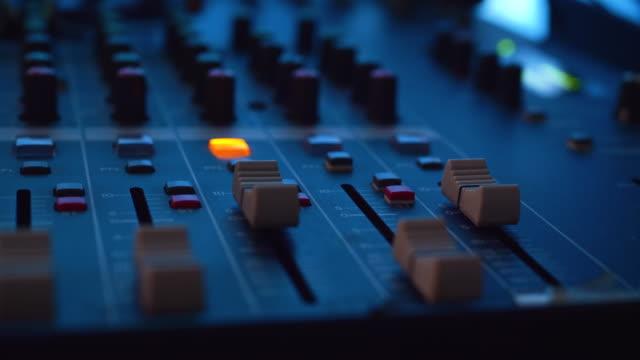 music control buttons studio music mixer equipment at studio room. - studio filmów i materiałów b-roll