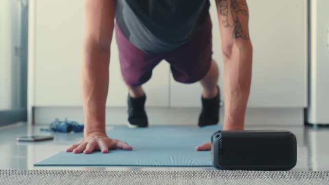 Music helps me to push myself even harder 4k video footage of a man connecting his cellphone his cellphone to a bluetooth speaker before working out bluetooth stock videos & royalty-free footage