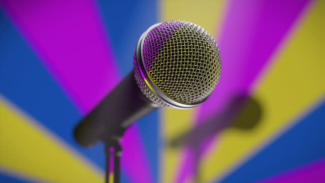 Music microphone on the stage karaoke bar against a colorful retro background