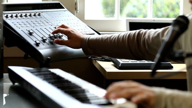 Musician at keyboard using mixer video