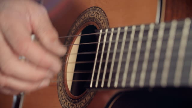 Musician playing an acoustic guitar in a recording studio Musician playing an acoustic guitar inside a recording studio musical theater stock videos & royalty-free footage