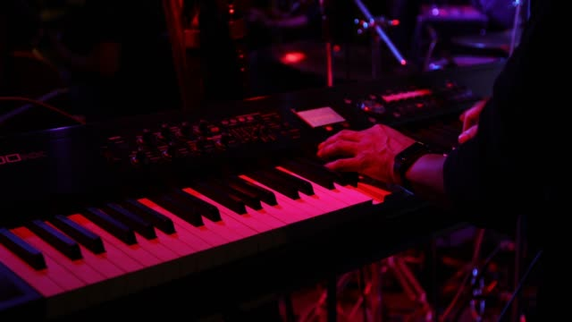musician playing keyboard in concert video