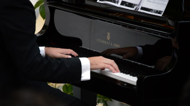 Musician playing piano Steinway Sons