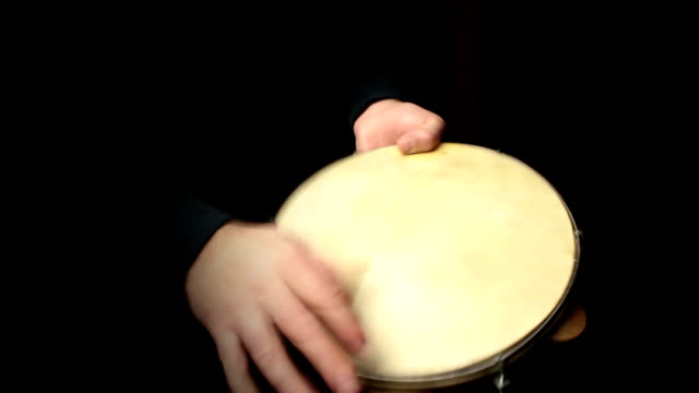 musician plays a rhythm with the pandeiro, percussion instrument video