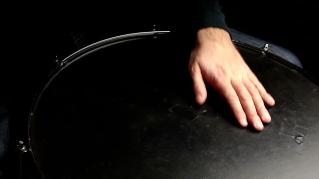 musician plays a rhythm with the surdo drum, percussion instrument video