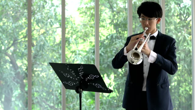 musicians are practicing saxophone New musicians are practicing saxophone blowing, music about the New Year festival from music notes. classical concert stock videos & royalty-free footage