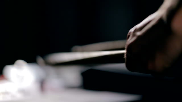 vídeos de stock e filmes b-roll de musician's hands play on electronic pads with drumsticks - bateria instrumento de percussão