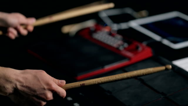 vídeos de stock e filmes b-roll de musician's hands play on electronic pads with drumsticks - compositor