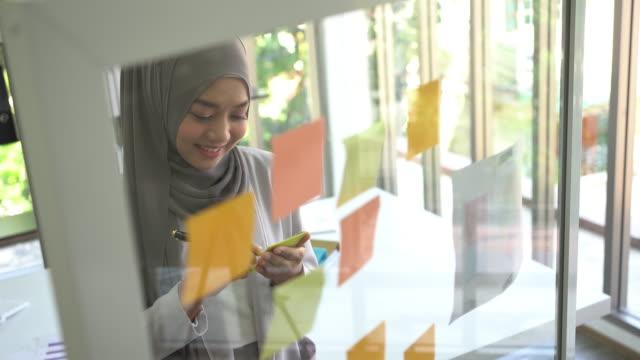 Muslim Business Woman working in office.