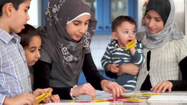 muslim children studying language in the kitchen - arab стоковые видео и кадры b-roll