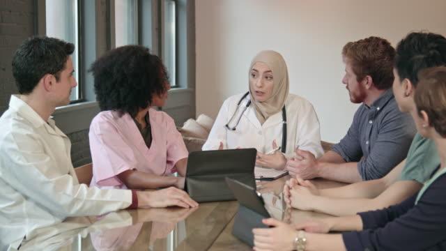 Muslim Female Doctor Leads Multi-Ethnic Medical Team WS video