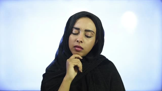 Muslim girl wearing Hijab thinking and looking tired and bored with depression problems