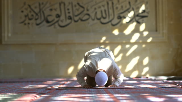muslim man praying in mosque - ramadan stock videos and b-roll footage