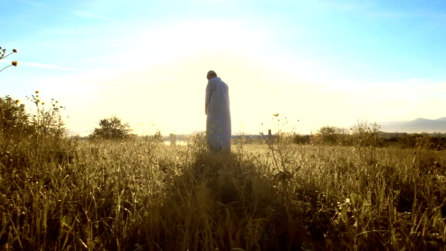 HD DOLLY: Muslim Man Praying In The Grass video