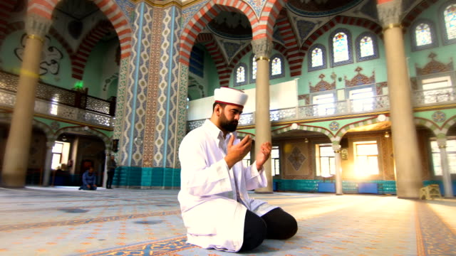 Muslim Man Prays 4K, 29,97P, Real Time hope concept stock videos & royalty-free footage