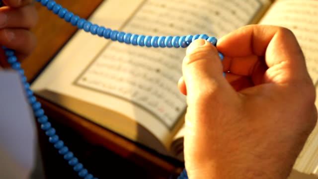 muslim man prays with a rosary - ramadan kareem стоковые видео и кадры b-roll