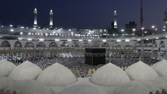 Muslim pilgrims circumambulate the Kaaba at Masjidil Haram in Makkah, Saudi Arabia video