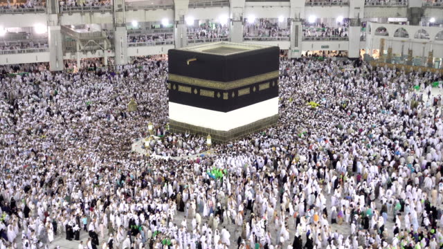 muslim pilgrims touring the holy kaaba in mecca in saudi arabia - ramadan stock videos and b-roll footage