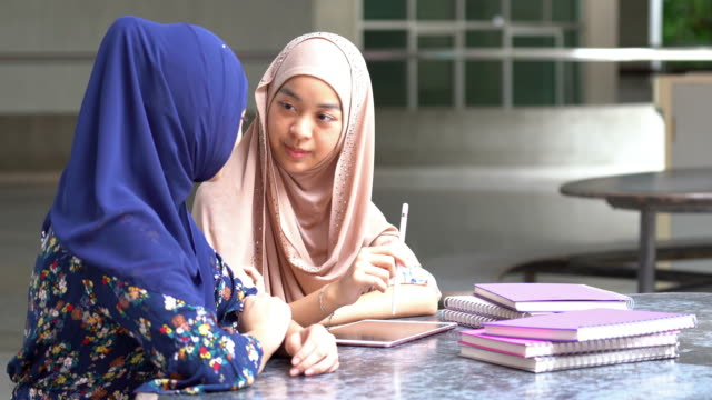 Muslim university college students reading book together 4K Muslim university college students reading book together, Apple ProRes 422 (HQ) 3840x2160 Format indonesia stock videos & royalty-free footage