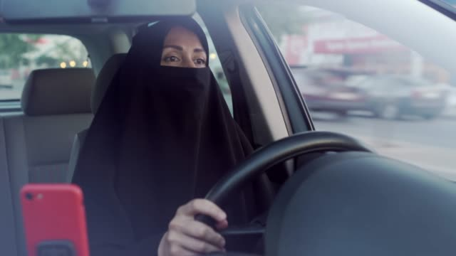 muslim woman driving a car - arabia saudita video stock e b–roll