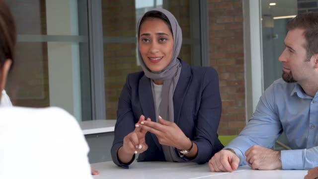 Muslim woman leads meeting video