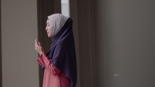Muslim woman praying with copy space. Happiness of Muslim woman praying with copy space. prayer stock videos & royalty-free footage