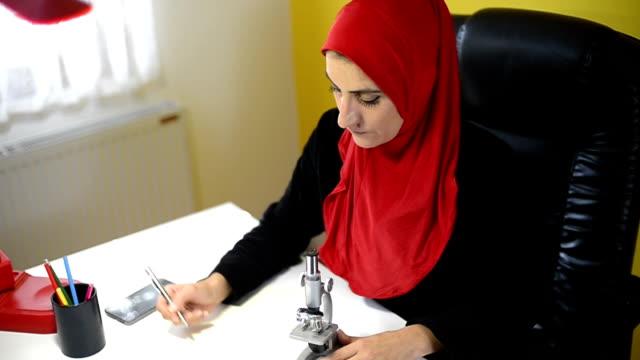 Muslim woman researcher. video
