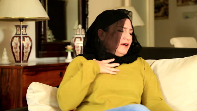Muslim woman using asthma inhaler video