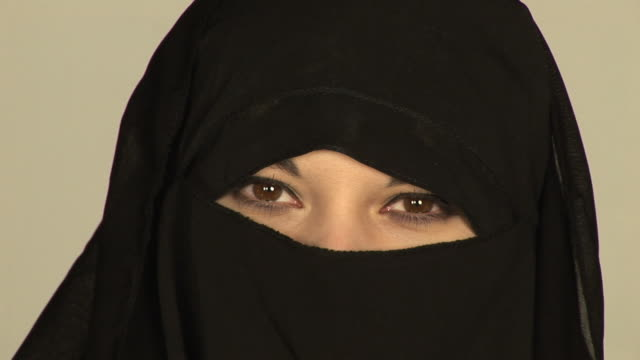 Muslim woman wearing Burqa/Burkha veil - HD & PAL video