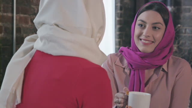 Muslim Women Enjoy Coffee or Tea Together video