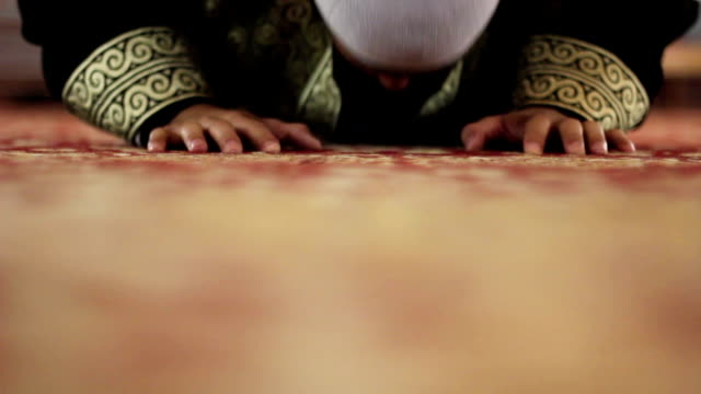 muslim young reverend worship in a mosque. video