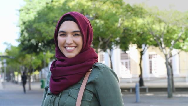 muslim young woman wearing hijab - arab стоковые видео и кадры b-roll