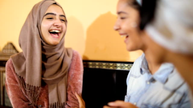 Muslim young women having a lunch break together in an Arab restaurant video