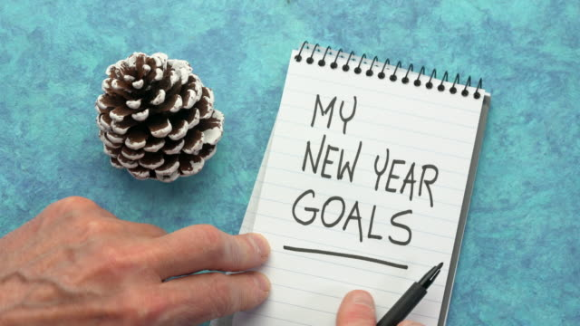 my new year goals - man hand writing with a black marker - new year filmów i materiałów b-roll