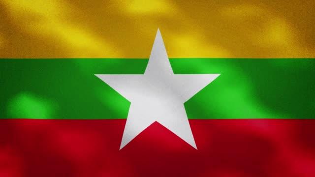 myanmar densa bandiera tessuto sventola, anello di sfondo - naypyidaw video stock e b–roll