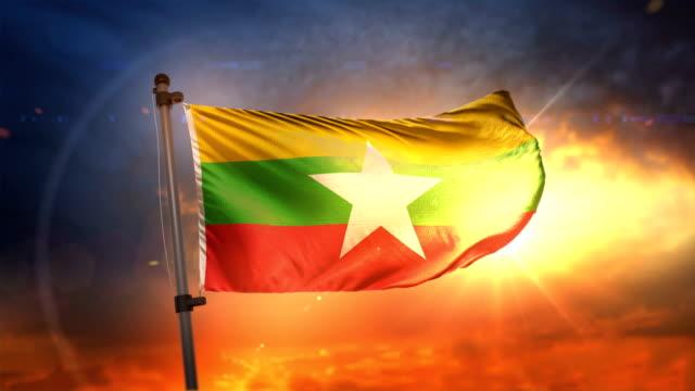 myanmar flag backlit at beautiful sunrise loop slow motion 4k - naypyidaw video stock e b–roll