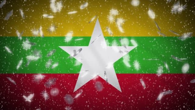 bandiera myanmar che cade spazzaneve, sfondo capodanno e natale, ansa - naypyidaw video stock e b–roll
