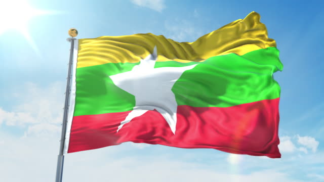myanmar flag waving in the wind against deep blue sky. national theme, international concept. 3d render seamless loop 4k - naypyidaw video stock e b–roll