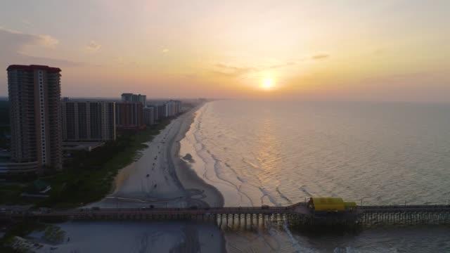 vídeos y material grabado en eventos de stock de myrtle beach, carolina del sur, ee.uu. drone skyline aerial - embarcadero