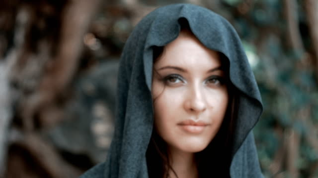 Mysterious beautiful woman with make up in grey hood video