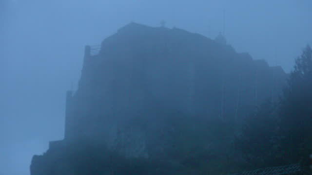 Mysterious haunted castle, church on top of mountain hidden in video