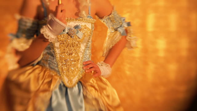 Mysterious Princess portrait with Masquerade Mask mysterious young woman in baroque style costume with carnival mask portrait on golden wallpaper background looking on you. (lensbaby used to create specific effect) renaissance architecture stock videos & royalty-free footage