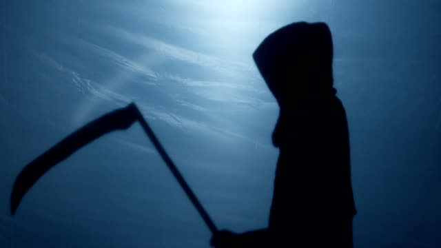 Mysterious shadow of Grim Reaper putting scythe down, blood-chilling death video