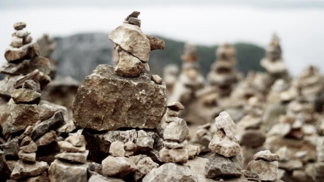 mysterious stone towers on a rocky coastline - mitologia video stock e b–roll