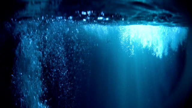 Mysterious underwater scenery with bubbles. Bright object in background Underwater life. Sunbeam creating striped pattern, surface slowly waving undersea stock videos & royalty-free footage