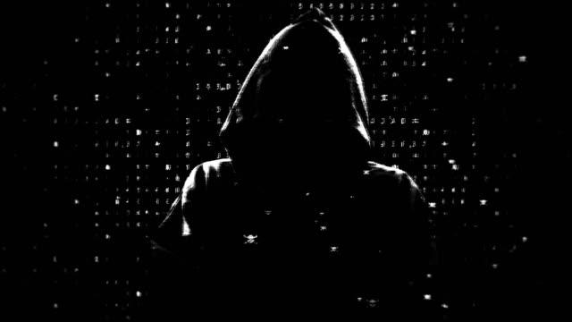 vídeos de stock e filmes b-roll de mystical silhouette of a hacker - capuz