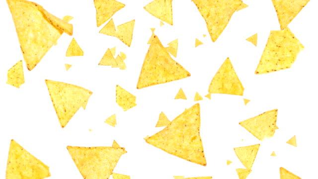 Nachos falling down Nachos falling down on white background potato chip stock videos & royalty-free footage