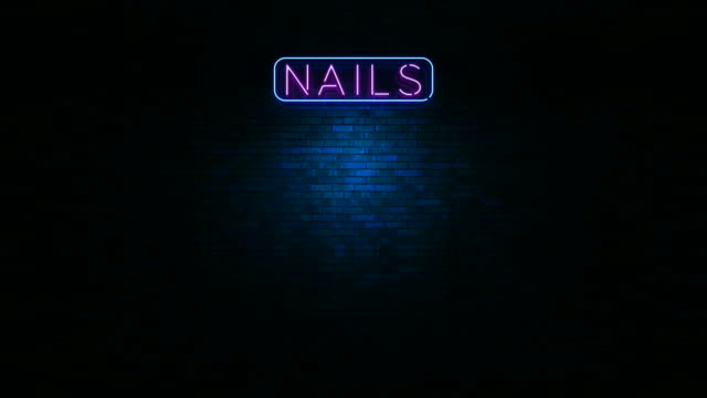 Nails Neon Light Sign Animation of neon sign with word nails in a wall at the night housing logo stock videos & royalty-free footage